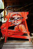 Red wheel contraption. Machinery used in the olden days in a mill Royalty Free Stock Photography