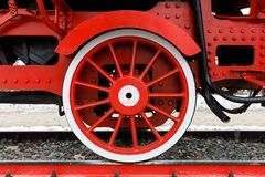 Red wheel and detail of mechanism a vintage russian steam train locomotive.  stock image