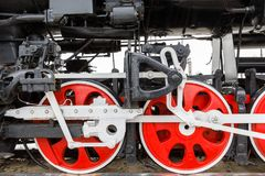 Red wheel and detail of mechanism a vintage russian steam train locomotive Stock Images