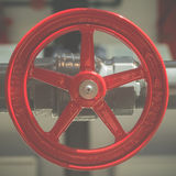 Red Wheel  Handle Turn to Open. Vintage Opening Valve on Pipeline Royalty Free Stock Photography