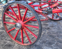 Red wheel of old-style carriage Stock Photos
