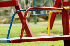 Red Wheel Park. A red wheel park alone, waiting for the children who use it Stock Photo