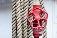 Red wheel, stop valve and ropes on a Tall Ship Royalty Free Stock Images