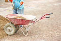 Red wheelbarrow with sand stock photos
