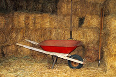 Red wheelbarrow, straw bales Stock Photos