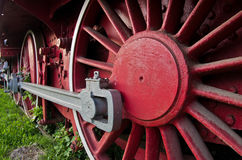 Red wheels of big old steam locomotive from Orient Express Stock Images