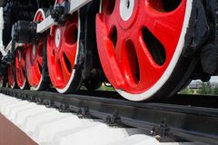 The red wheels of the locomotive Stock Photography