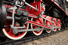 Red wheels of the old express. Steam train Stock Photos