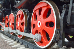 Red wheels of old locomotive. Red wheels on an old steam train Royalty Free Stock Photography