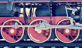 Red wheels of old steam locomotive Royalty Free Stock Photo