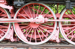 Red wheels and pistons on an old locomotive Stock Images