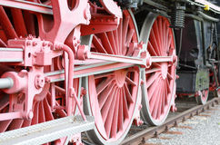 Red wheels and pistons on an old locomotive Royalty Free Stock Images