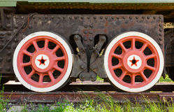 Red wheels with stars of railway gun system Royalty Free Stock Photo
