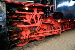 Red wheels of steam train. Royalty Free Stock Image