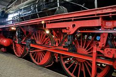 Red wheels of steam train. Royalty Free Stock Photos