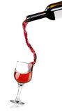 Red whine pouring into a crystal glass Stock Image