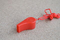 Red whistle on the floor Stock Photos