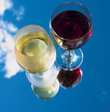Red or white?. Detail of red & white wine - reflected Royalty Free Stock Image