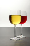 Red and white. Wine against bi-colored background Stock Photography
