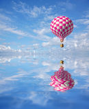 Red-white 3d balloon. 3d balloons in the blue sky and reflection in water Stock Photography