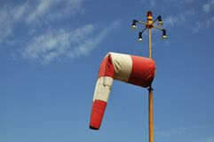Red and white airfield windsock Stock Images