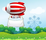 A red and white airship carrying an empty banner Royalty Free Stock Photography