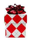 Red and white argyle patterned Christmas gift box isolated Royalty Free Stock Images