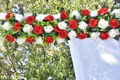 Red and white artificial roses on the wedding royalty free stock image