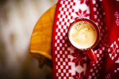 Red and white background with mug of coffee. Christmas red and white background with mug of coffee Royalty Free Stock Images