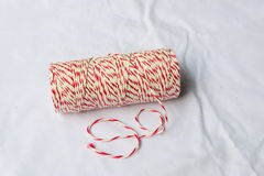 Red and white baker's twine spool Royalty Free Stock Photography