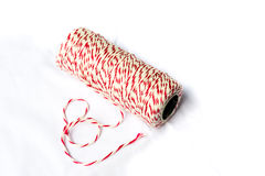 Red and white baker's twine spool Stock Photo