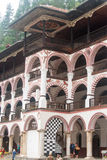 Red and white balconies Rila Monastery in Bulgaria Royalty Free Stock Photography