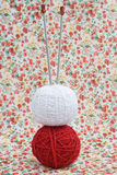 Red and white ball of yarn for knitting and needles on a background Stock Photography