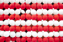 Red and white balloon wall Stock Image