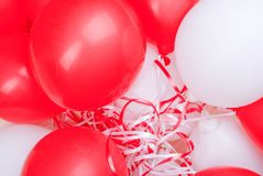 Red-white balloons on the board Stock Images