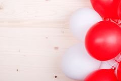 Red-white balloons on the board Stock Photos
