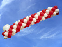 Red and white balloons isolated on blue sky background Stock Image