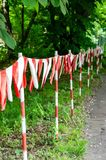 Red and white barrier tape blocking the way stock photo