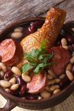 Red and white beans with chicken legs and sausages vertical Royalty Free Stock Images