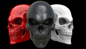Red, white and black angry skulls. Isolated on black background Royalty Free Stock Photography