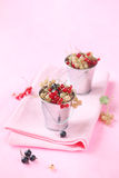 Red, White and Black Currants. On a light pink background Stock Photo