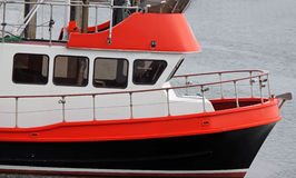 Red, White and Black Fishing Boat Royalty Free Stock Image