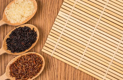 Red, white, and black rice in a wooden spoon Stock Image