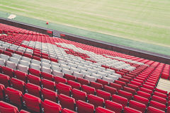 Red and White Bleachers on a Open Stadium Royalty Free Stock Images