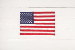 Red, White and Blue American Flag in Center on Off White Faux Painted, Rustic Textured Wood Boards Background. Stock Photography