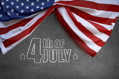 Red, white and blue american flag for 4th of July. On blackboard background Stock Photos