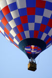 Red, White and Blue Balloon. A colorful red, white and blue hot air balloon at the annual Kannapolis, North Carolina Hot Air Balloon festival Stock Photo