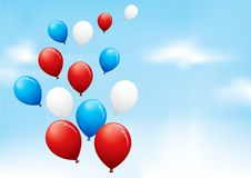 Red, white and blue balloons. Floating in a cloudy sky Royalty Free Stock Photo