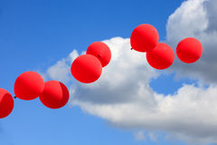 Red, White and Blue Balloons in Sky. Red balloons floating in air and contrasted against white clouds and blue September sky in Leesburg Virginia Royalty Free Stock Photo