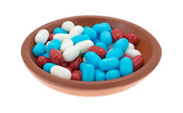 Red white and blue breath mints in a bowl Royalty Free Stock Photo